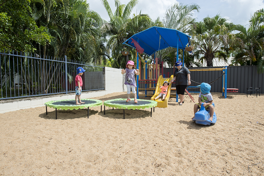 Children playing in outdoor play area at Milestones Palmerston